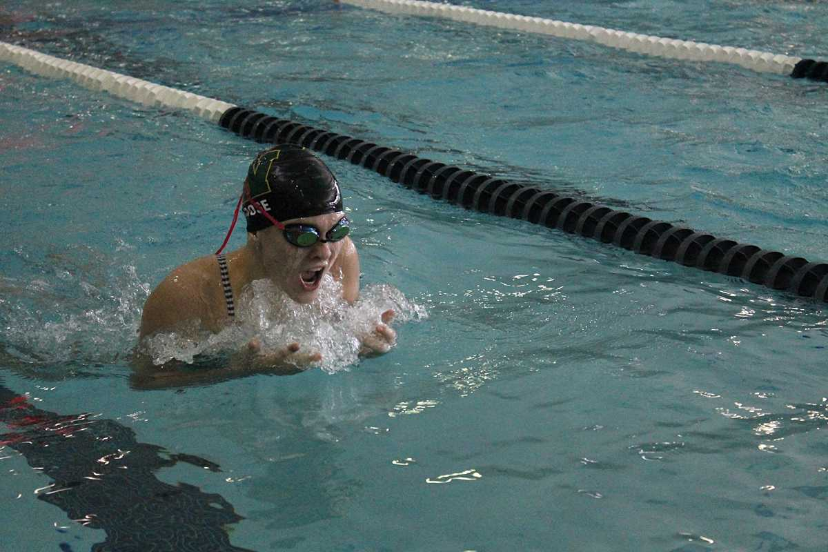 Lily Ernst swims breaststroke in the 200 IM