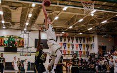 Trojan basketball wins big at first home game