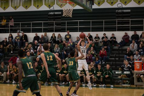 Photo gallery: boys basketball defeats Dubuque Hempstead