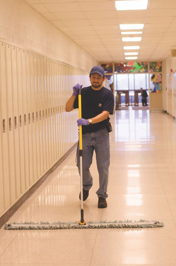 Carlos+mopping+the+art+hallway.+Photo+by+Sarah+Longmire