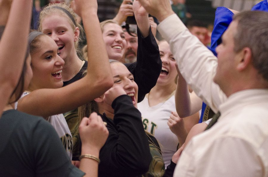West+High+girls+celebrate+with+Coach+Meyer+after+their+substate+win.