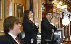 Lexi Weber '14 stands with the speaker of the house to welcome a group of visitors.