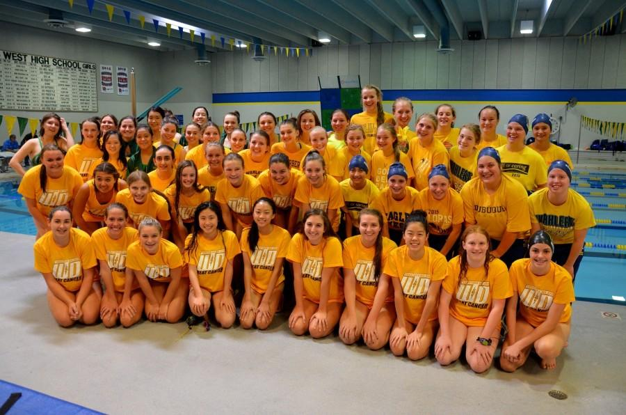Girls+swim+team+comes+together+for+gold+out