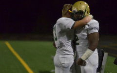 Max Brown `17 hugs senior player Yeshuwa Hicks `16 after the last game of the season against Bettendorf.