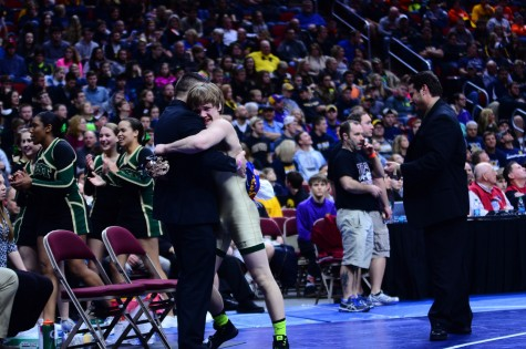 Nelson Brands `18 hugs Assistant Coach Kody Pudil after winning the 2016 3A 138 pound state title.