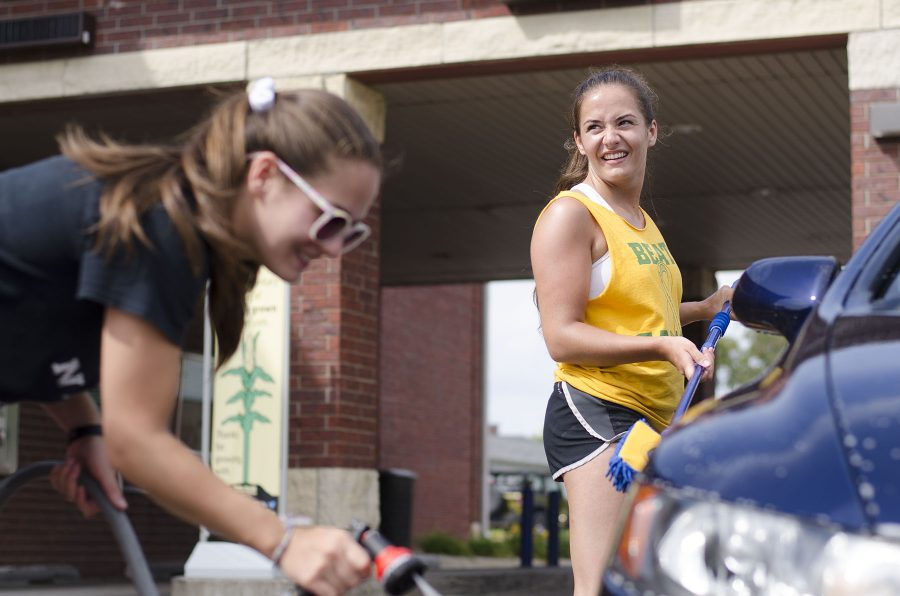 Bridget Mckenna '17 and Caitlyn Mckenna 17' washing a car to raise money for dance marathon.