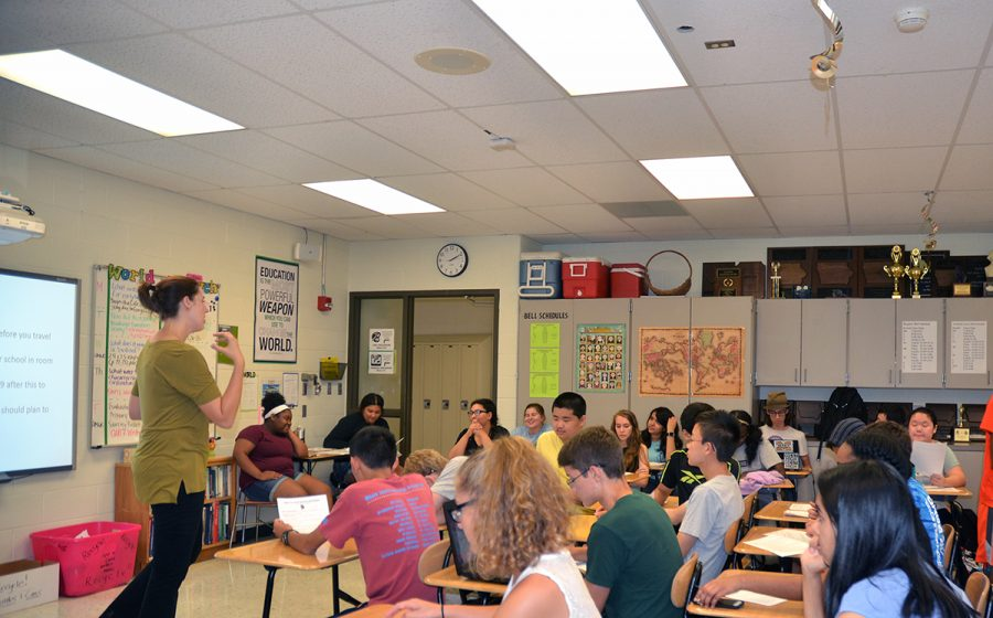 Head Coach Megan Johnson talks to new members, at room 232 during the first debate meeting.