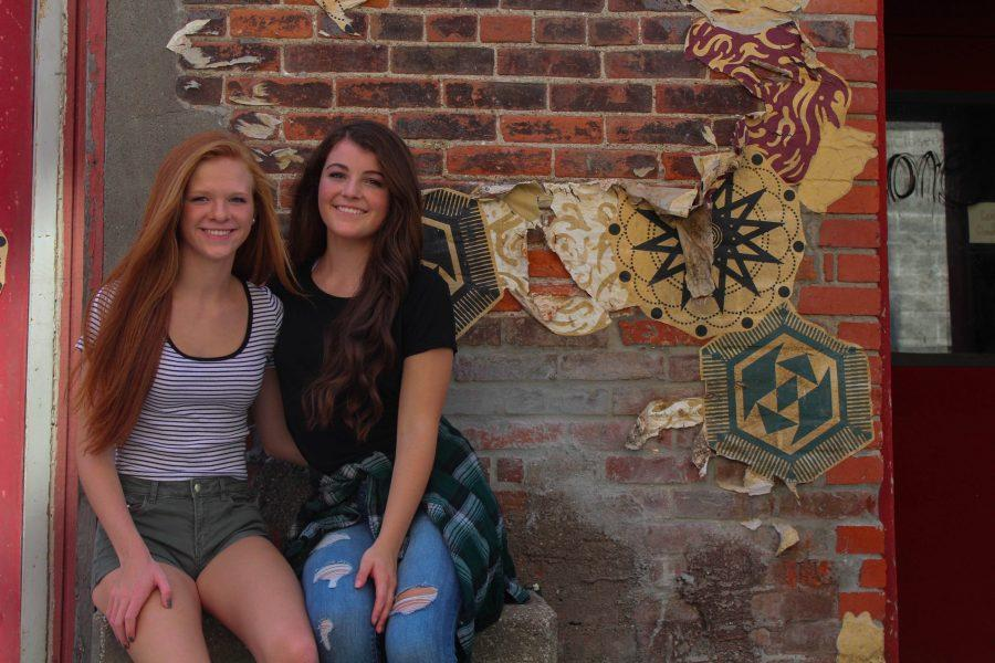 Issy Gray '18 and Taylor Grider '18 posing at Iowa City Downtown