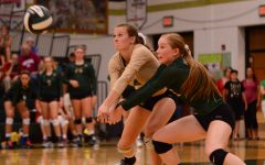 Madi Ford 17 and Gabby Kleme 17 work together to make sure the ball gets over the net. (Sarah Longmire)
