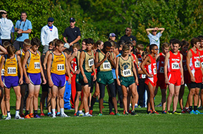 The+varsity+team+stands+at+the+starting+line+before+a+race.