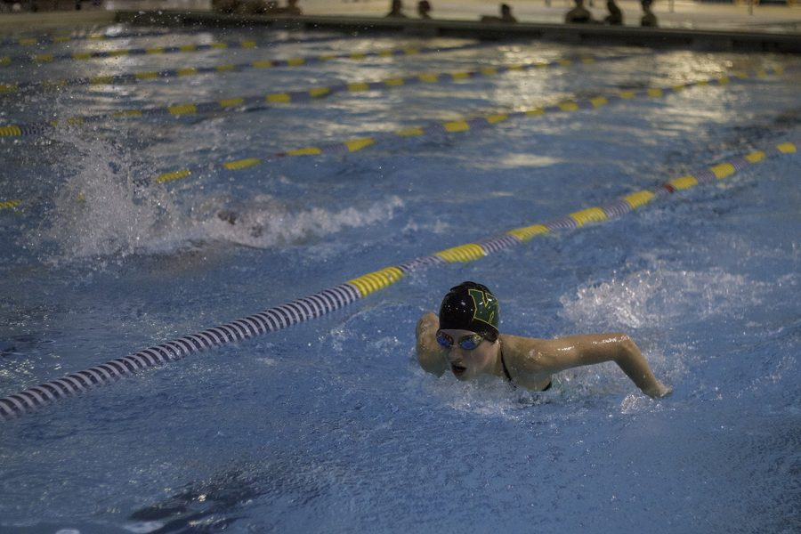Abby Caylor '20 swims butterfly.