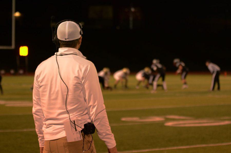 Head Coach Garrett Hartwig watches his team on their way to beating Linn-Mar, 50-7, on Oct. 14.