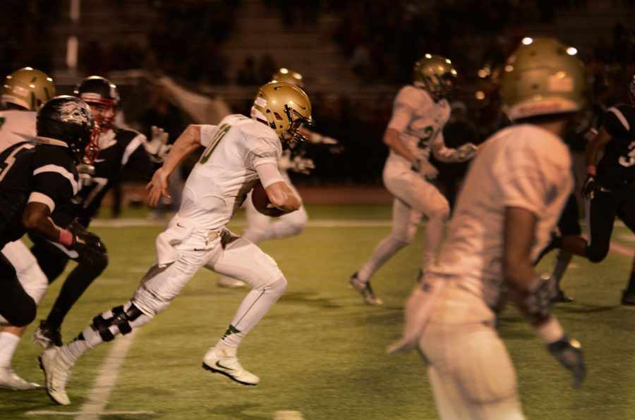 Quarterback Evan Flitz `18 runs the ball during West's win (50-7) against Linn-Mar on Oct. 14.