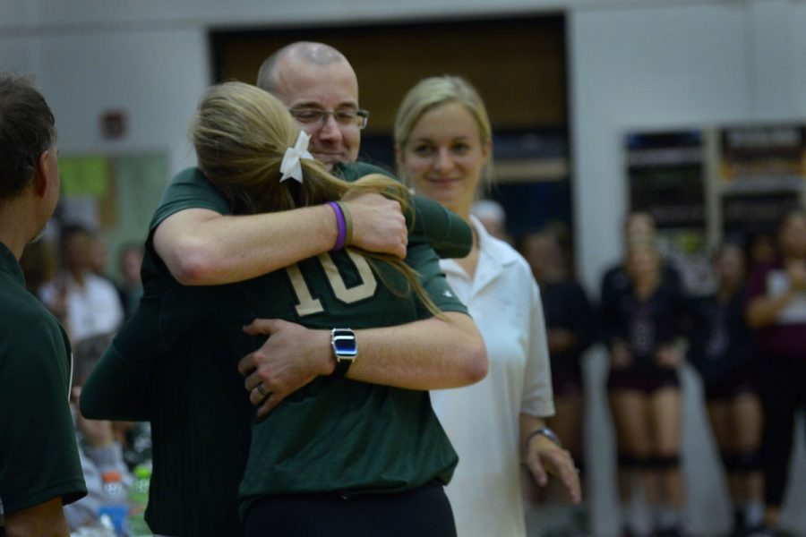 Assistant+Coach+Scott+Sanders+hugs+Ali+Tauchen+%6017+as+she+is+honored+during+Senior+Night.+%0APhoto+by+Leah+Dusterhoft