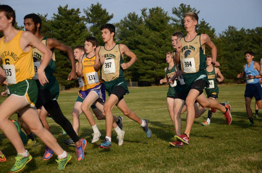 Jared+Bailey+%2718%2C+Andrew+Murley+%2717+and+Ali+Ali+%2717+run+at+the+2015+State+Cross+Country+Championships.