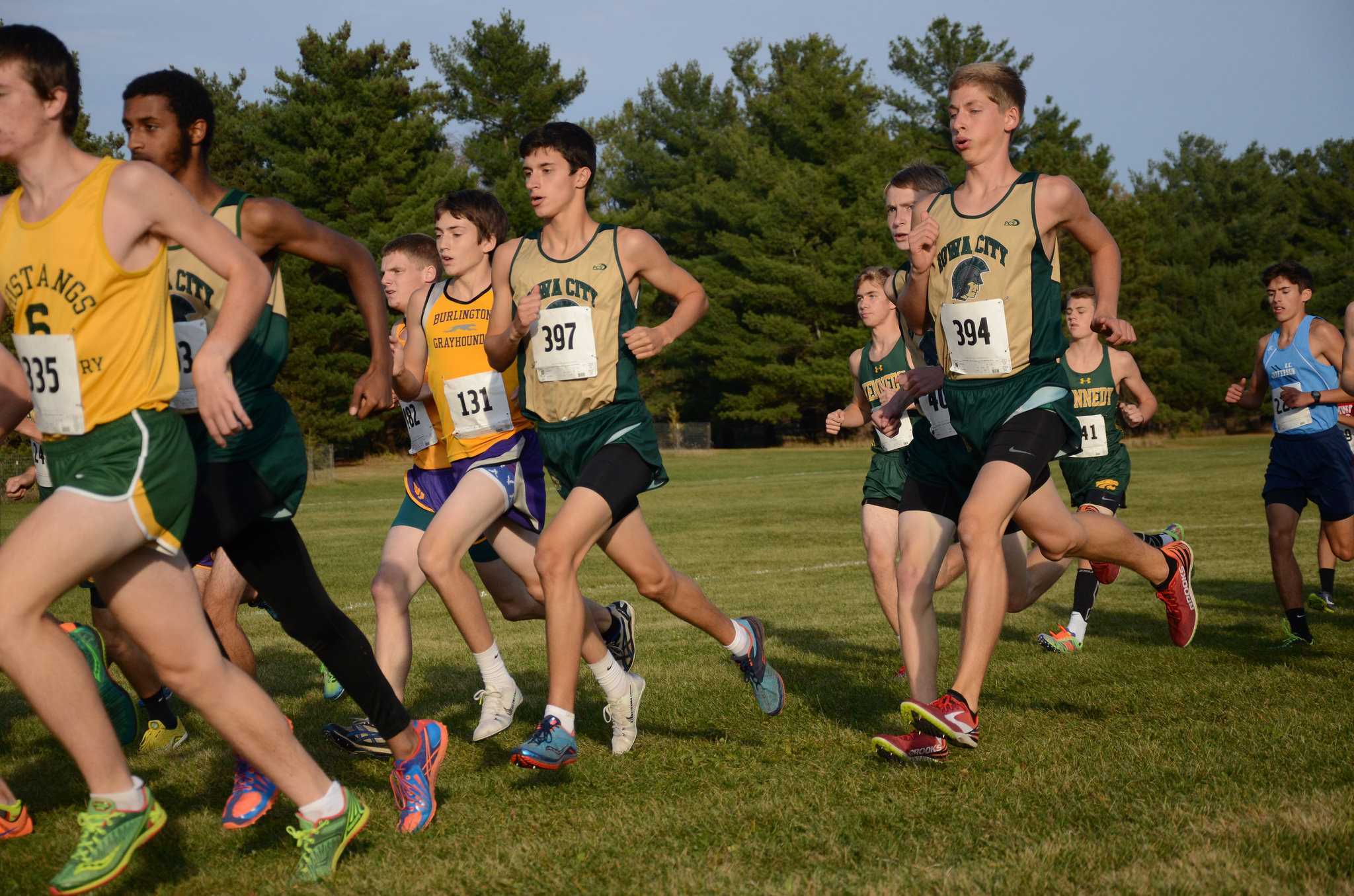 Jared Bailey '18, Andrew Murley '17 and Ali Ali '17 run at the 2015 State Cross Country Championships.