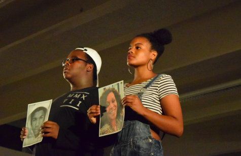 Damarius Levi '19 and Jade Merriwether '17 hold up pictures of African-Americans unjustly killed.