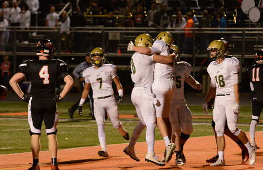 Austin West `18 and teammates celebrate the first touchdown of the game. West high beat Prairie, 38-14 to move onto the State Semifinals.