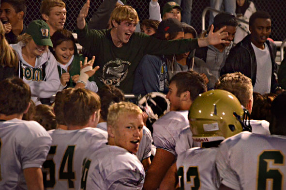 Players and fans celebrate after West high beat Prairie, 38-21 to move onto the state semifinals.