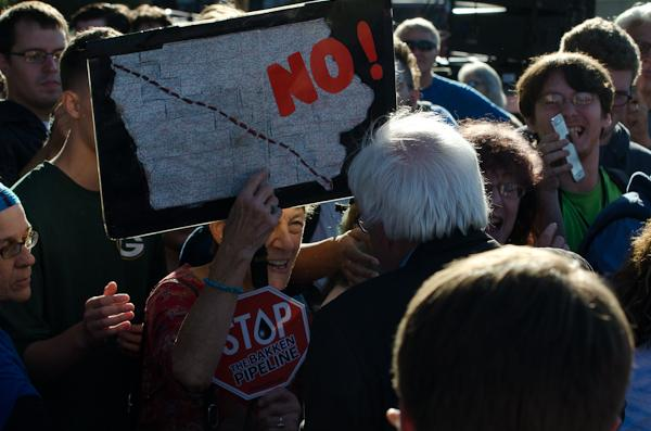 A protester against the Bakken Pipeline expresses their concerns with Sen. Sanders.