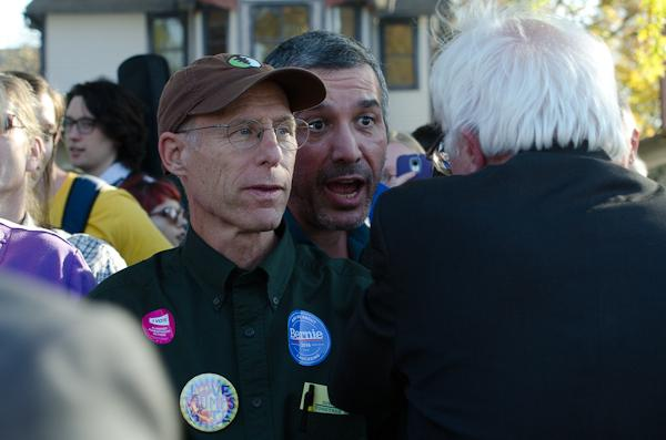 Bernie supporter John Macatee introduces himself to the Senator.