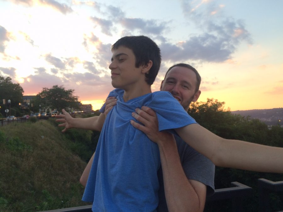 Robert Walling '18 recreating the Lion King scene in Pittsburgh with youth leader Kevin Graf