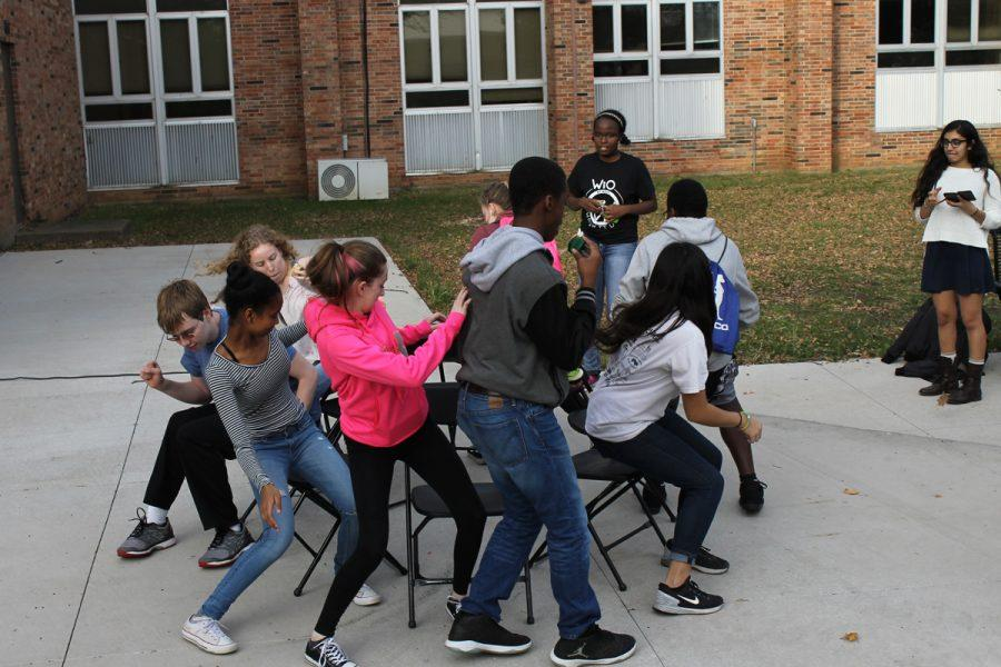 a group of West High student compete to get a seat while playing musical chairs  (Allie Schmitt-Morris)