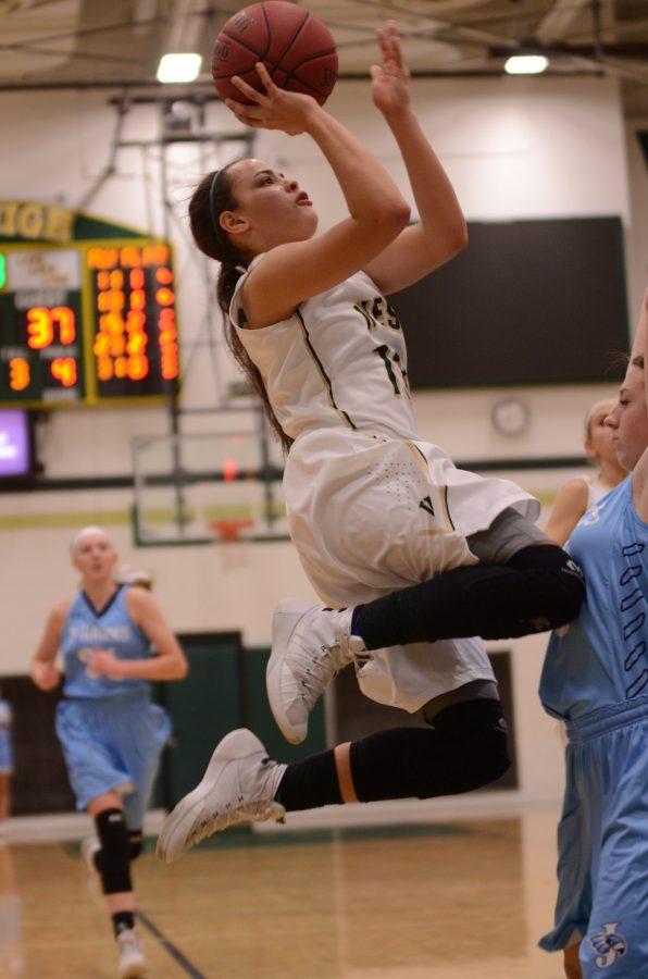 Rachael Saunders 18 competes against Cedar Rapids Jefferson.