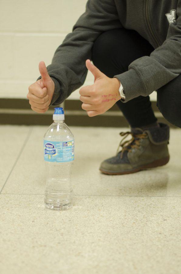 Behind the water bottle flip