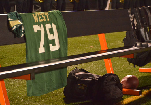 During the football game on Nov. 4, the team draped Tony Beminio's jersey on their bench to remember the fallen alum.