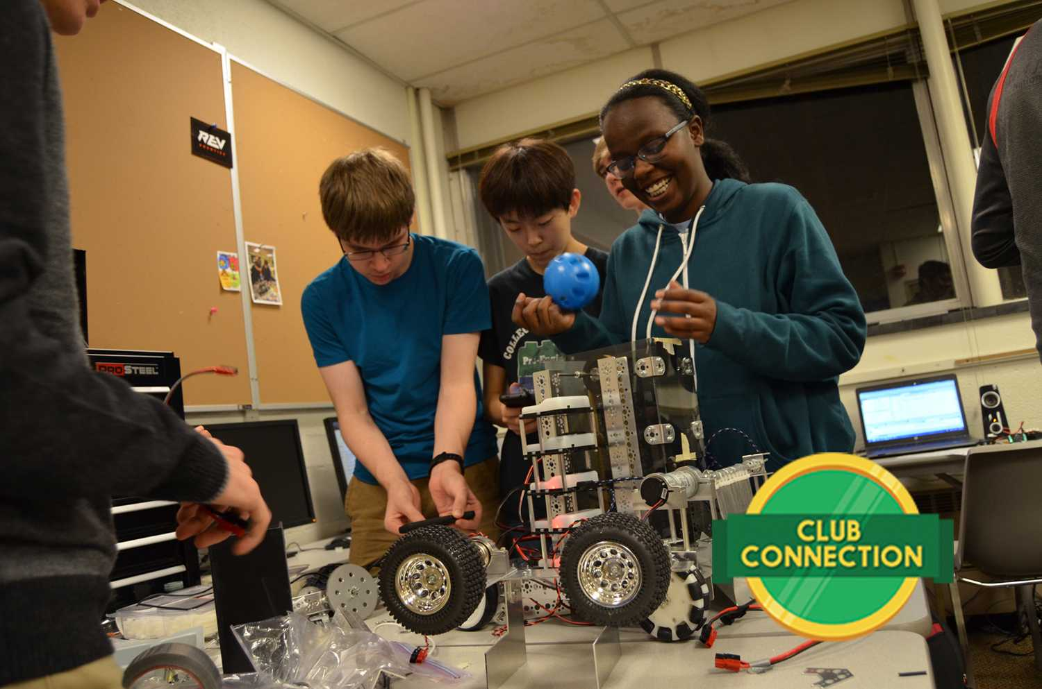Yegor Kuznetsov '20, Jeongwoo Seo '18, and Eman Elsheikh '18 work on their robot's elevator on Tuesday at the Roosevelt education center. The elevator will carry the balls to the launcher