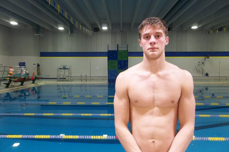 Brennon Keen '18 stands by the Coralville Recreation Center swimming pool. The No. 9 ranked Trojans faced No. 10 Cedar Rapids Washington on Tuesday, Jan. 10.