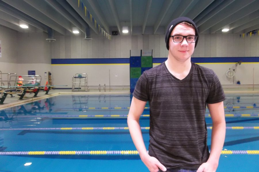 Ben Schroeder stands by the Coralville Recreation Center swimming pool after practice.  The No. 9 ranked Trojans faced No. 10 Cedar Rapids Washington on Tuesday, Jan. 10.