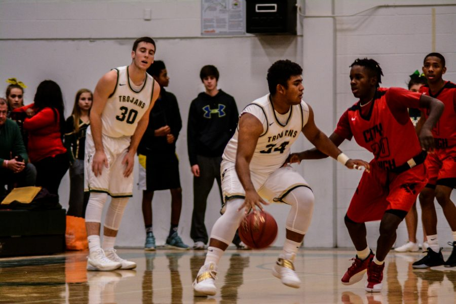 Izaya Ono-Fullard '17 dribbles the ball against a City defender as Connor McCaffery '17 looks on.