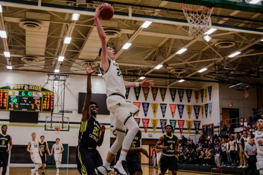 Patrick+McCaffery+%2719+goes+for+a+dunk+against+Marian+Catholic.