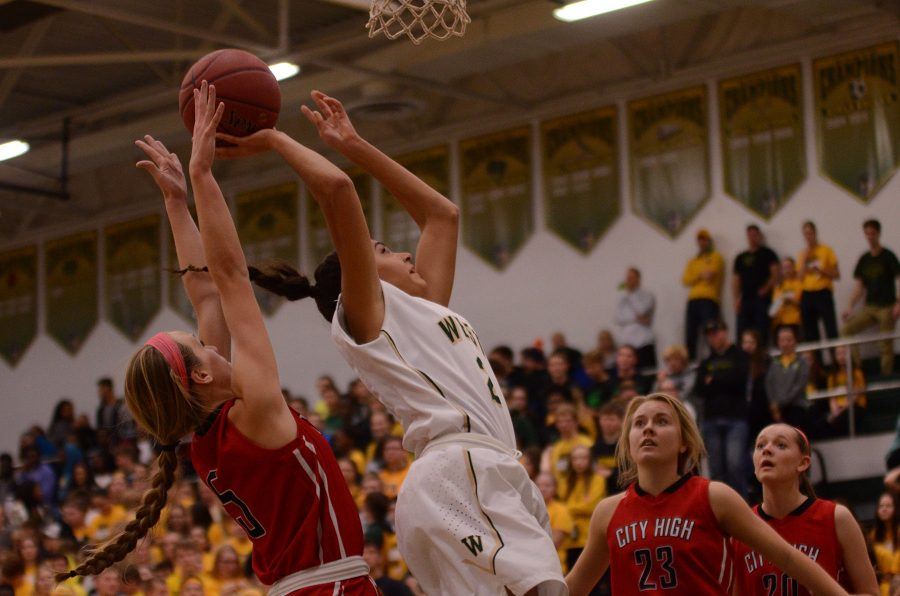 Caitlyn Morgan 19 bends back to shoot a basket.