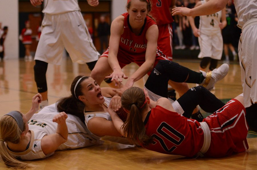 Rachael Saunders 18 fights for ball with City Highs Aubrey Joans 20.