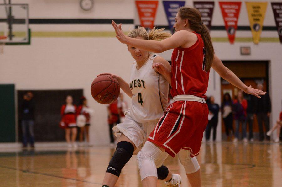 Lauren Zacharias 19 drives towards the basket.