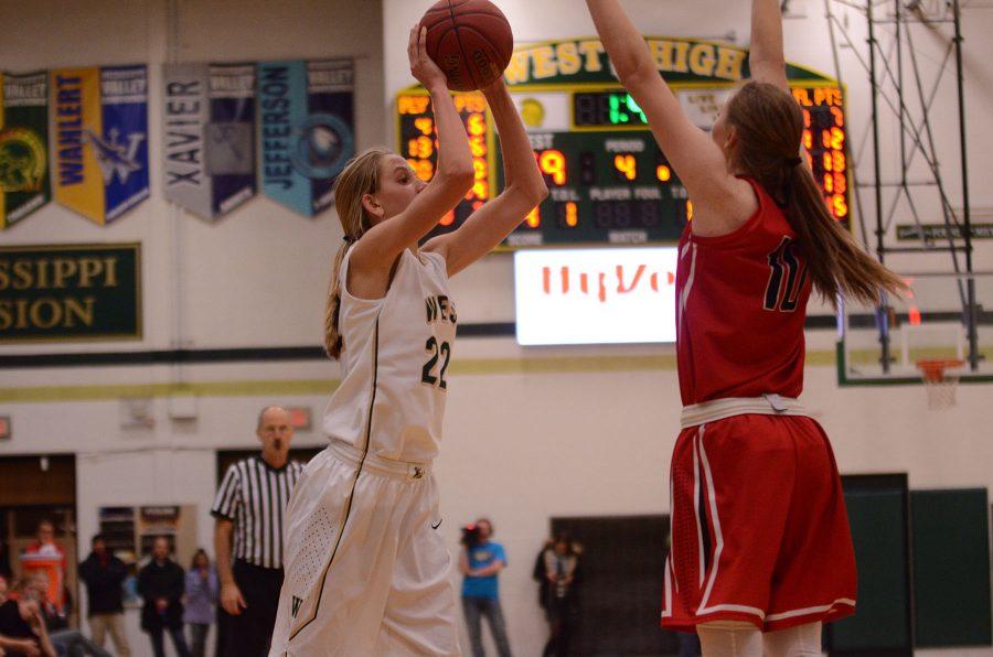 Logan Cook 18 passes the ball.