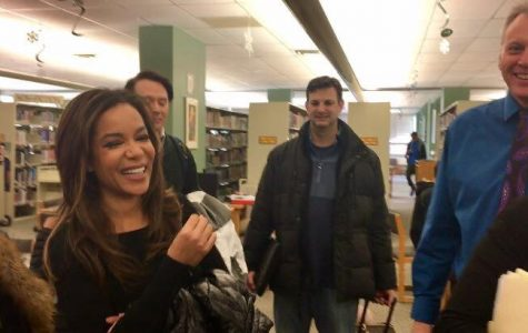 The View reporters Sunny Hostin and Clay Aiken talk with producers and Principal Gregg Shoultz after conducting student interviews in West High's library before school Jan. 6.