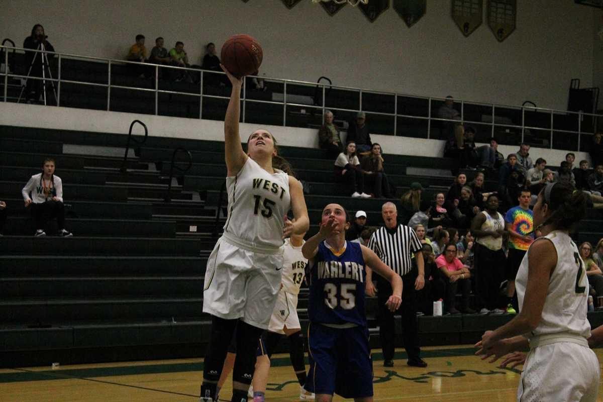 Katie McGrane '17 shoots a jump shot