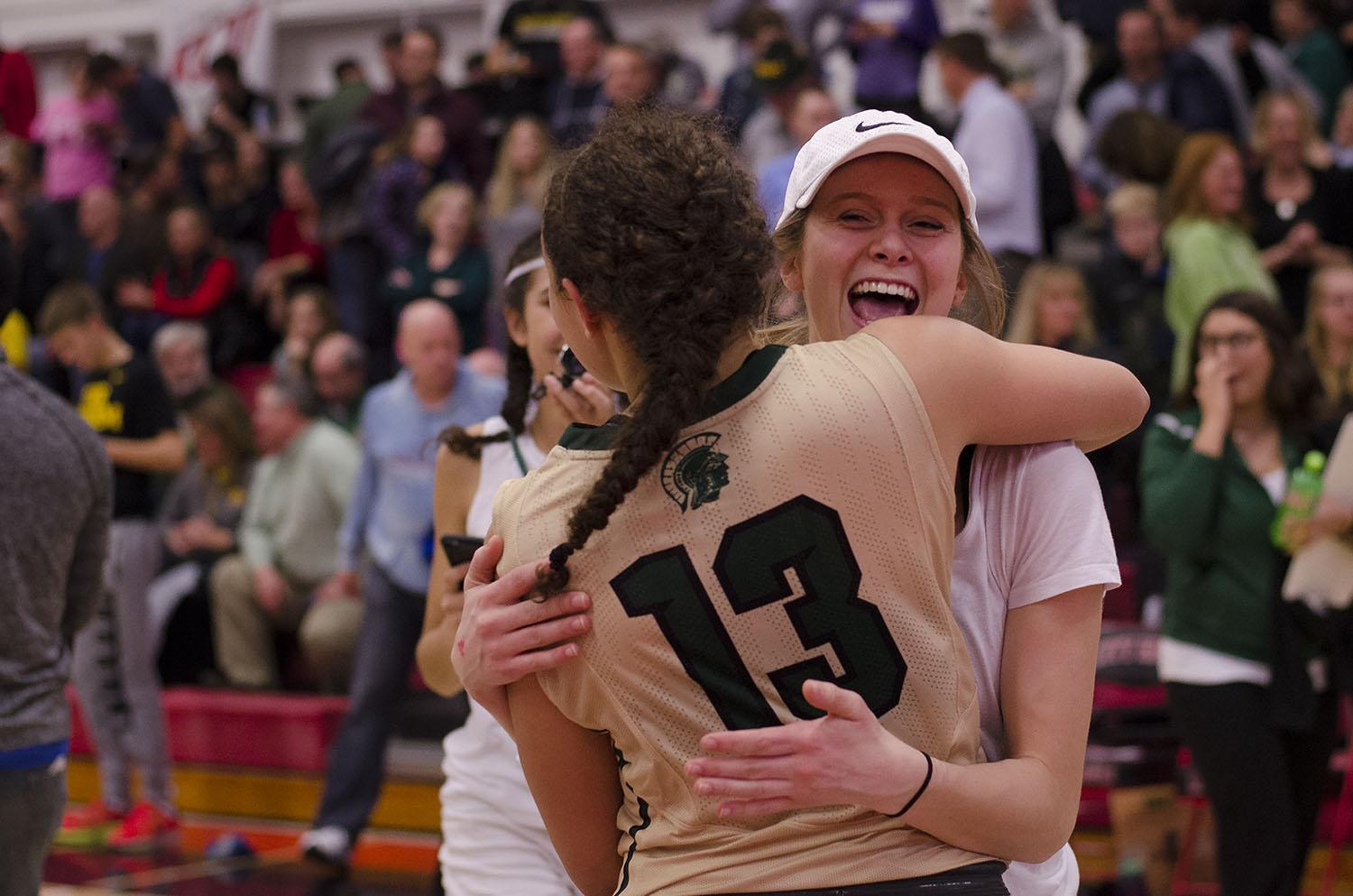 Madi Ford '17 hugs Rachael Saunders '18 after their 5 point victory over City. Rachel said before the game that she wanted to break City's record and tonight she was able to accomplish that goal.