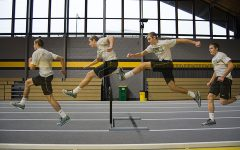 Cole Mabry '19 practicing at University of Iowa's indoor track facility with his trainer Ethan Holmes. He goes through hurdle drills and speed work during practice.