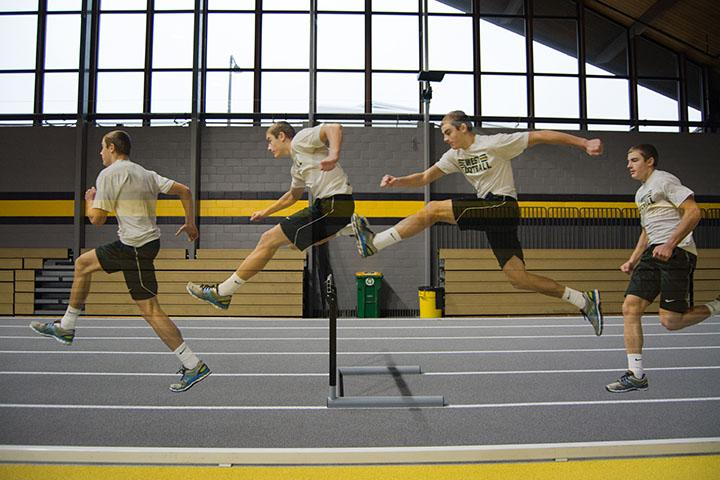 Cole+Mabry+%2719+practicing+at+University+of+Iowa%27s+indoor+track+facility+with+his+trainer+Ethan+Holmes.+He+goes+through+hurdle+drills+and+speed+work+during+practice.