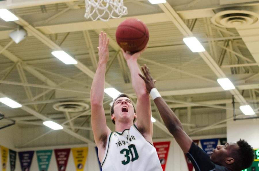 Connor+McCaffery+%2717+is+fouled+by+Trevon+Montgomery+%2717.+McCaffery+will+score+one+point+at+the+free+throw+line+and+further+West%27s+lead+against+Pleasant+Valley+to+5-0+in+the+first+quarter.
