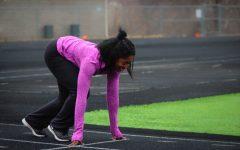 Kia Noibi '18 captured at the starting pose before beginning a run around the track.