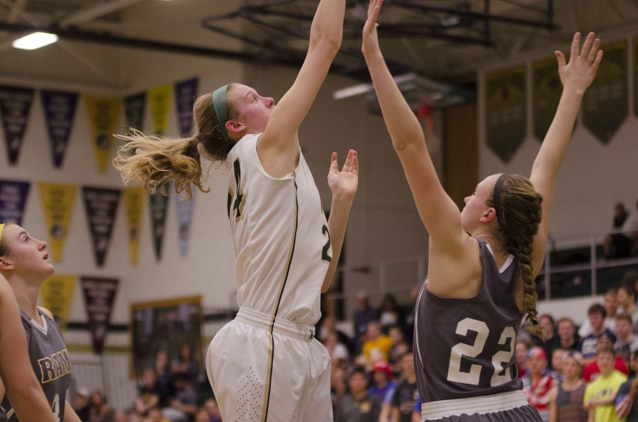 Emma Koch '19 shoots while being blocked by South East Polk.