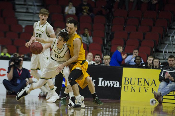 Patrick McCaffery '19 gets hit by Kennedy in the 4a state semifinal at Wells Fargo Arena on Friday Mar. 10.