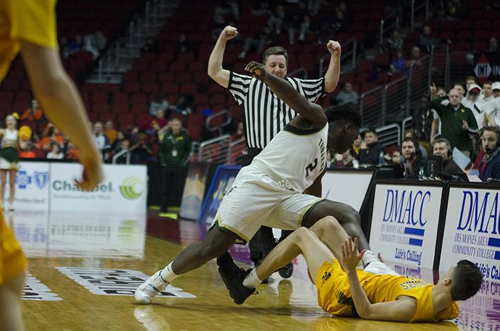Devontae Lane '17 tumbles with Kennedy's defense in the 4a state semifinal at Wells Fargo Arena on Friday Mar. 10.