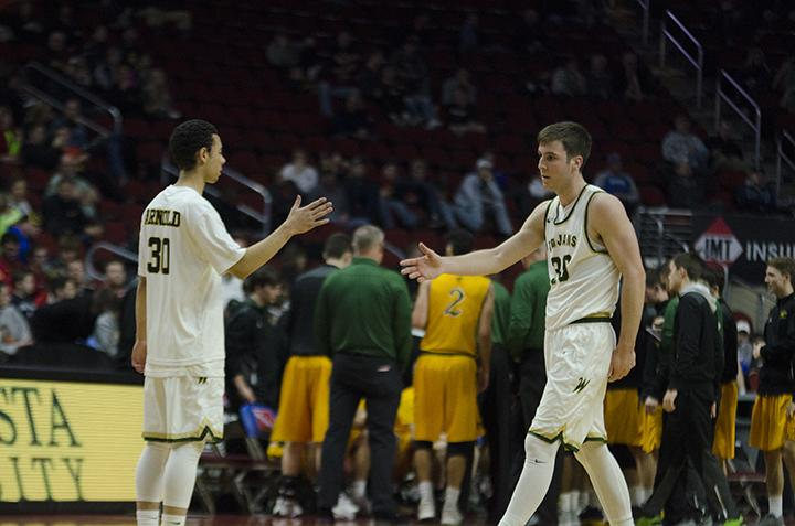 Jake Anderson '18 gives teammate Connor McCaffery '17 a high five.